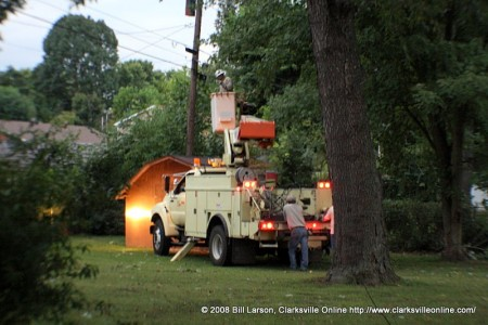 A CDE Electrical truck in the backyard of a home doing electrical repair work after the storm.