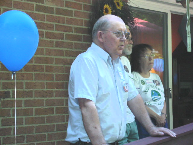 Thurston Smith, president-SCDP, speaks as Jim and Nan Robertson listen during their Dover for OBama Hse Party