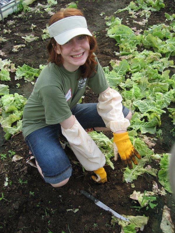 the-food-initiative-5-girl-tending-crop