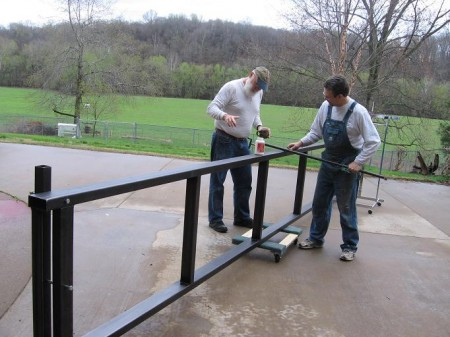Barry Kitterman helps David Boen build a retractable ramp for the stage of Cats.