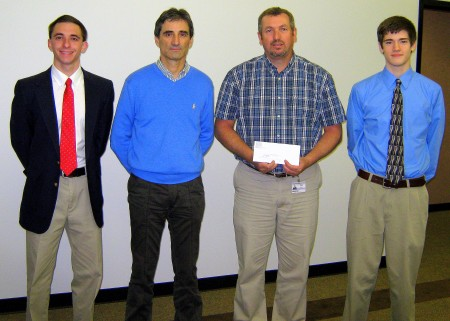 Alex Silkowski, APSU marketing student (left); Giancarlo Adani, Florim USA vice president of operations; Tim Swaw, Florim USA human resources manager; and Aaron Taylor, APSU computer science student (right). Photo by Sharon Silva APSU University Advancement