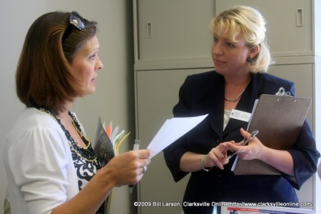 Katie Nolen discussing job opportunities with a Wendy Harrison from the Clarksville-Montgomery County Career Center