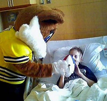 Clarksville Fox Mascot Trixy visiting Tyler Russell in the hospital