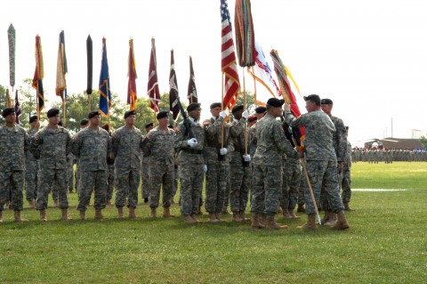 Maj. Gen. John F. Campbell receives the 101st Airborne Division (Air Assault) colors from Gen. Charles C. Campbell, commander of U.S. Forces Command, during a change-of-command ceremony at Fort Campbell, Ky., July 31.