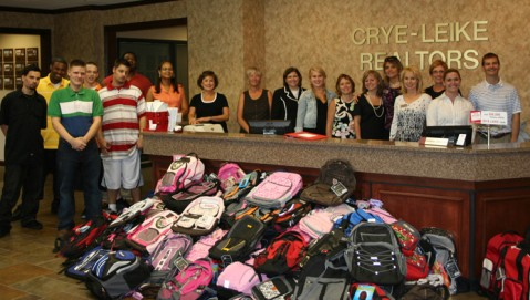 Children and staff from Youth Villages prepare to pick-up nearly 300 donated backpacks from Crye-Leike, REALTORS Agents at the company's Brentwood West Regional Headquarters in August 2008