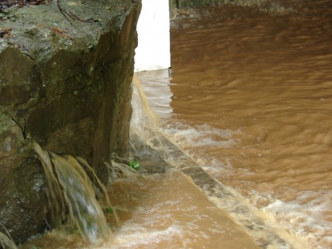 This is how caves are formed, water rushes out of cracks in the rocks