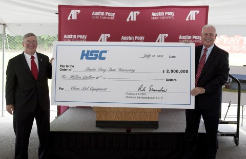 APSU President Tim Hall (left) is presented with a $2 million contribution from Hemlock Semiconductor Group, represented by Terry Strange, site manager of the new Hemlock Semiconductor plant in Clarksville. (Rollow Welch/APSU Public Relations and Marketing)