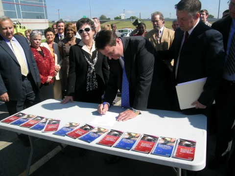 TDOT Chief Engineer Paul Degges, surrounded by key safety partners, signs the new Strategic Highway Safety Plan