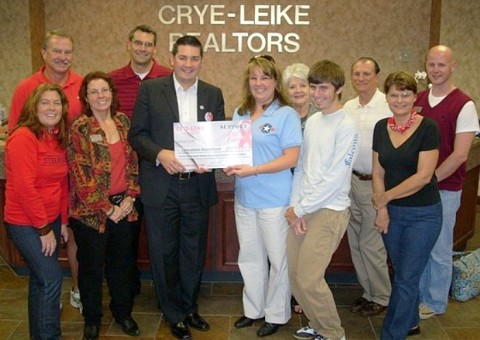 Crye-Leike, REALTORS Presents Its First Big Check of $3,771 to Operation Homefront. Pictured Left to Right: Romney Hill, Paula Fuller, Rob Hatchett, Operation Homefront Representative Tina Englen, Englen's son, Jill Solava, Digger Williams, Ben Claybaker, Linda Brock, Joe Lehman, David Thomas.