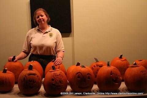 Park Interpeter Amy Wallace with some of the many pumpkins carved by Suva Bastin and herself