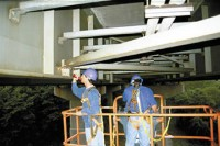 A bridge inspector performs an inspection of a steel girder as part of the visual inspection study.