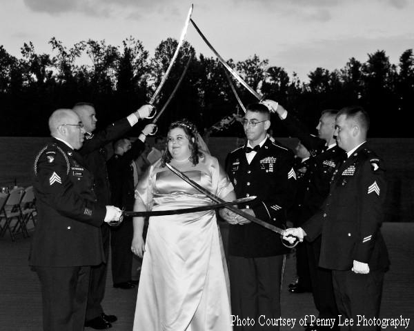 Matt and Ashley Parsons walk through the Military Arch of Sabers at the Sept. 4 wedding.