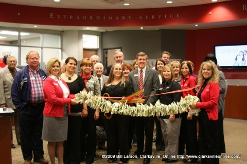 Fort Campbell Federal Credit Union employees, Board of Directors and Clarksville/Montgomery County Chamber Ambassadors at the ribbon cutting for Fort Campbell Federal Credit Union's 9th Branch