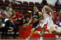Oakland City Guard Jared Manners taking the ball down court against the APSU defense