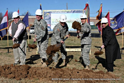 Major General John F. Campbell (center) leads the groundbreaking for the new Commissary on Fort Campbell