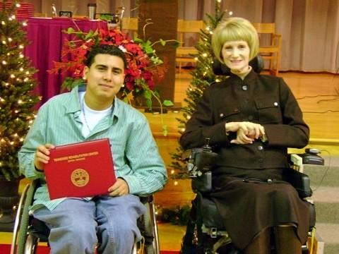 TRC student speaker Jose Ortega and DHS Assistant Commissioner of Rehabilitation Services Andrea Cooper.
