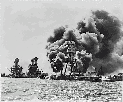 The aftermath of attack, The USS West Virginia (severely damaged), USS Tennessee (damaged), and the USS Arizona (sunk).