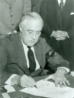 President Roosevelt signing the official Declaration of War against the Axis powers (Japan, Germany, and Italy) in December 1941. (Library of Congress)