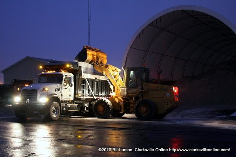 A bucket loader resupplies a empty salt truck at the TDoT Highway Department depot on Wilma Rudolph Blvd. after the morning snowfall.