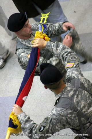 Command Sgt. Maj. Gregory Patton (Left) & Col. Viet Luong (Right), case the brigade colors.