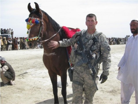 U.S. Army 1st Lt. James Ferguson, a fire support officer with Company A, 3rd Battalion, 187th Infantry Regiment, 3rd Brigade Combat Team, 101st Airborne Division, poses with a horse in Sharana city in Afghanistan's Paktika province, March 21, during the New Year's sangay festivities. Sangay is a competition in which men on horseback use spears to attempt to dislodge a spike from the ground. The Soldiers from 3-187 INF joined approximately 600 residents from the city for the celebration. (U.S. Army photo)