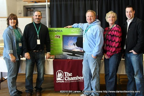 The Clarksville Area Chamber of Commerce with one of the televisions they gave away