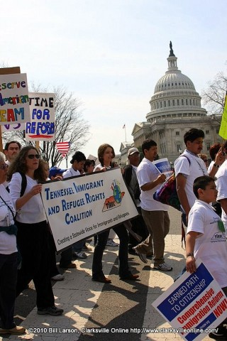 Members of  the Hispanic Organization for Progress and Education (H.O.P.E.) and the Tennessee Immigrant and Refugee Rights Coalition (TIRRC) march past the U.S. Capitol Building in Washington DC