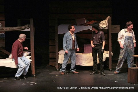 Candy (Jay Doolittle), George (Gili Getz), Curley (Matthew Patrick), and Lennie (Kevin Hauver) in the bunkhouse of the Ranch