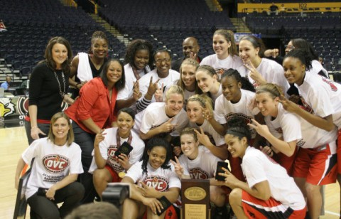 The Lady Govs pose with the 2010 OVC Tournament Championship trophy following their victory against Eastern Illinois, Saturday.