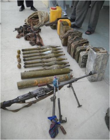 The cache contained one PKM Squad Automatic Weapon system, four cans of ammunition for the PKM, one handheld radio, nine Rocket Propelled Grenade-7 rockets, and various others miscellaneous items. (U.S. Army Courtesy Photo)