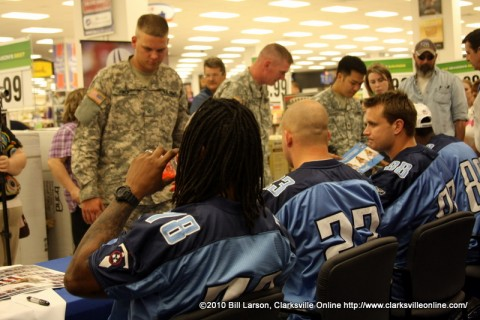 The Tennessee Titans visit with soldiers at the Fort Campbell PX.