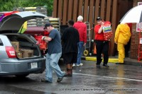 Wendy's employees load some of the perishable items into vehicles for relocation to other Wendy's locations
