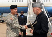 """The U.S. Army Major General John Campbell the Commanding General of the 101st Airborne Division (Air Assault) """"Screaming Eagles"""" presents the President of Afghanistan, Hamid Karzai a departing gift at Campbell Army Airfield, Fort Campbell, KY on 14 May 2010.  The President of Afghanistan, the Secretaries of Defense for the U.S. and Afghanistan, the Chairman of the Joint Chiefs of Staff and other distinguished visitors were on a short visit to Fort Campbell.    U.S. Army Photo by Sam Shore"""