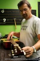 Randy Lewis tunes an instrument