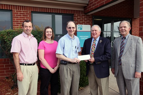 Premier Medical Group physicians Dr. Paul Darke, Dr. Stephanie Schultz and Dr. Bill Moore present the check to School Board Chair Jim Mann and Education Foundation Vice President Jimmy Dunn.