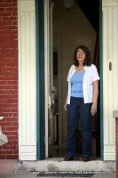 Owner Becky Hall personally welcomes the tour  to her lovely home