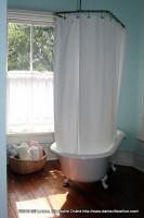 A elegant bathroom feagturing a genuine claw foot bathtub