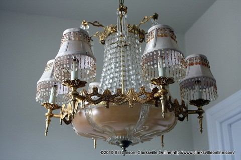 An ornate chandelier provides light for the central stairwell.