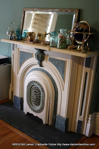 A working fireplace with an iron ornamental cover