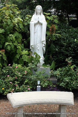 A statue of the Virigin Mary is the centerpiece of the Meditation Garden outside the Immaculate Conception Catholic Church