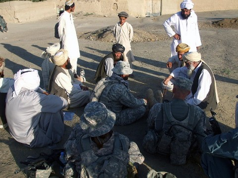 "Task Force Iron Soldiers speak with local tribal elders in the village of Jarkana at a ""shura"" or town meeting following a recent joint air-assault mission with members of the Afghan Uniform Police.  The village, located in Paktika Province, has historically been a Taliban safehaven.  Task Force Iron Soldiers hope to change that and help increase security for the village with assistance from the AUP."