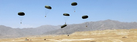 Resupply pallets parachute their way down to the ground during a resupply air drop mission at Forward Operating Base Gamberi, July 10th. The air drop was used to resupply the base as well as train the Afghan National Army soldiers on how to coordinate and conduct an air drop.