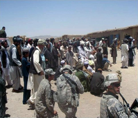 Afghan National Security Forces and Soldiers with 3rd Battalion, 187th Infantry Regiment, gather with local's in the Marjaneh Bazaar for a shura with the Waza Khawa Sub-Governor Mohamed Ramazan, June 28th. (U.S. Army Courtesy Photo)