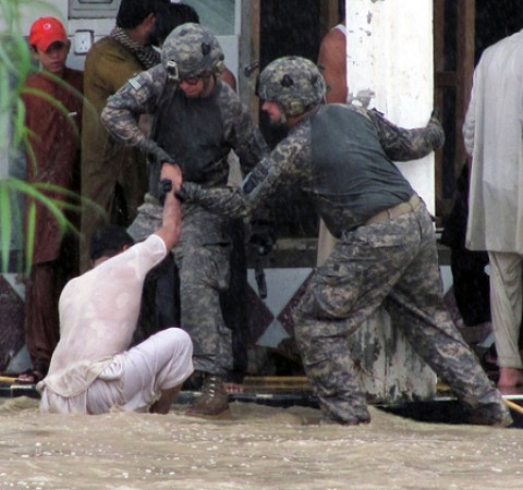 U.S. Army Sgt. 1st Class Patrick Stoner, of Latrobe, PA.,and U.S. Army Sgt. Robert Huff, of Erlanger, Ky., with the Military Police Platoon, Headquarters and Headquarters Company, Special Troops Battalion, Task Force Spartan, rescue an Afghan man from encroaching flood waters in the Nari Shahi village, Beshood District of eastern Afghanistan's Nangarhar province July 28th. (U.S. Army courtesy photo)