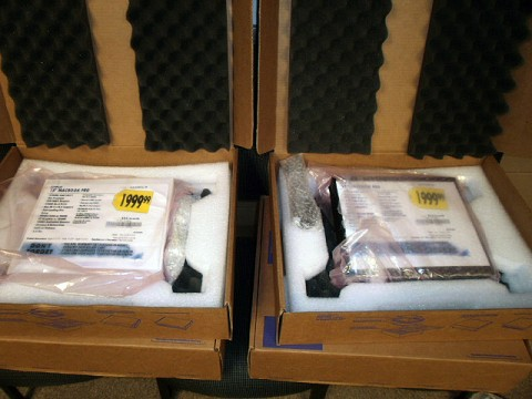 Two of the fake Apple Computer boxes with Best Buy sales tags. (Photos by: Officer Minetos)