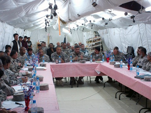 Lt. Col. Walter J. Smiley Jr., battalion commander, 3rd Special Troops Battalion, 101st Airborne Division (center left) listens as Maj. Gen. Mullah Khil, commanding general, ABP Zone 2 (center right) speaks at a recent commander's conference at Camp Ghardez.