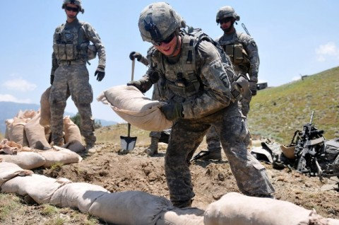 U.S. Army Pfc. David W. Wilson, of Salisbury, NC, a grenadier with 1st Squad, 2nd Platoon, 2nd Battalion, 327th Infantry Regiment, Task Force No Slack, stacks sandbags in an effort to improve a fighting position at Combat Outpost Thomas above the Marawarah District here July 7th.(Photo by U.S. Army Spc. Albert L. Kelley, 300th Mobile Public Affairs Detachment)