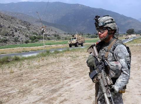 U.S. Army Cpl. Daniel R. Sabedra of San Antonio, Texas, a team leader with 4th Platoon, Company D, 1st Battalion, 327th Infantry Regiment, Task Force Bulldog, pulls security during a stop near Perone village here July 20th. (Photo by U.S.Army Staff Sgt. Gary A. Witte, 300th Mobile Public Affairs Detachment)
