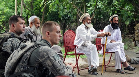From left, U.S. Army Sgt. 1st Class Kenneth R. Shriver of Clarksville, TN, a platoon sergeant, and 1st Lt. Hugh A. Lewis of Layton, Utah, a platoon leader, both with 1st Battalion, 327th Infantry Regiment, Task Force Bulldog, join with elders of the village of Shamun in eastern Afghanistan's Kunar province July 14th to listen to discussions of various local programs. (Photo by U.S. Army Staff Sgt. Gary A. Witte, 300th Mobile Public Affairs Detachment)