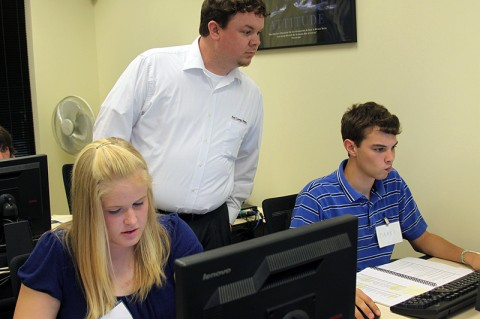 Students Michelle Ferguson, RHS, and  Jared Cornelius, NEHS, receive instruction from FCFCU training instructor David Wilhelm.